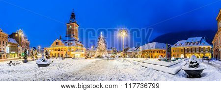 BRASOV ROMANIA - 29 DECEMBER 2014: Night image of Christmas Market in Brasov December 2014. Main Square and Council House landmark of Transylvania Romania.