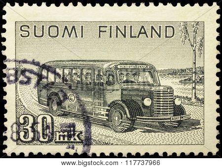 Old Postal Bus Rides On Rural Road