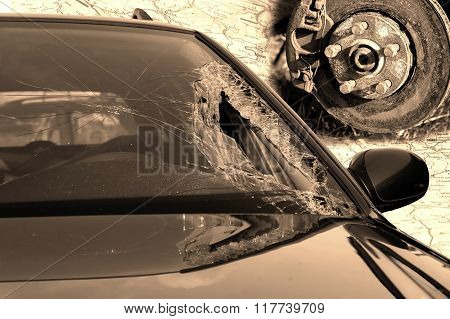 Broken windscreen at black car in traffic accident and disc brake