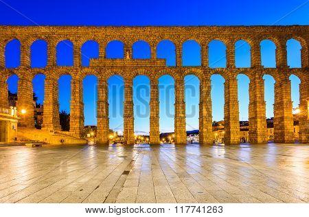 Segovia Spain. Plaza del Azoguejo and the ancient Roman Aqueduct from 1st century AD of Roman Empire.