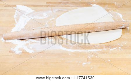 Rolling Pin And Rolled Dough On Table