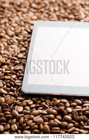 the computer tablet on coffee beans