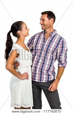 Couple looking at each other standing on white screen