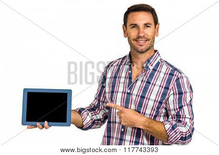 Man showing tablet screen at camera on white screen