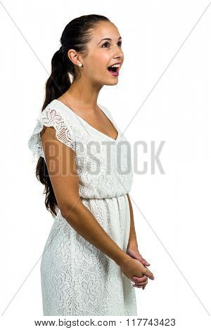 Surprised woman with open mouth looking up on white screen