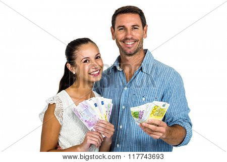 Young couple holding money on white screen