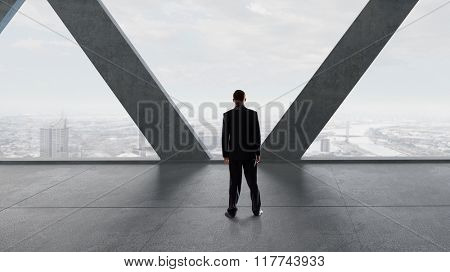 Businessman in modern interior