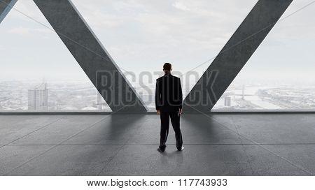 Businessman in modern interior