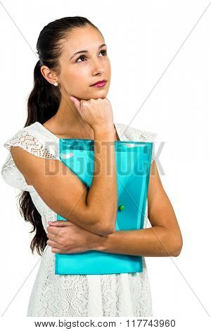 Thoughtful woman holding plastic folder with fist on chin on white screen