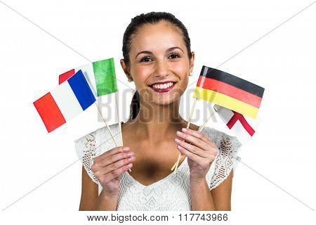 Confident woman holding flags on white screen