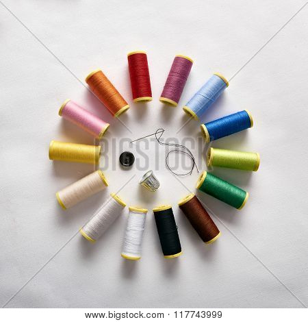 Spools Of Thread In Circle With Needle Thimble And Button