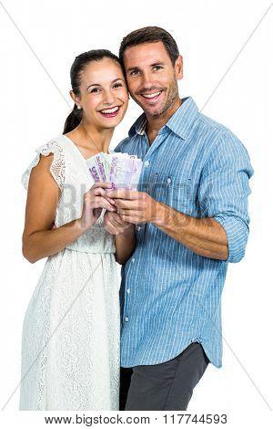 Happy couple holding money on white screen