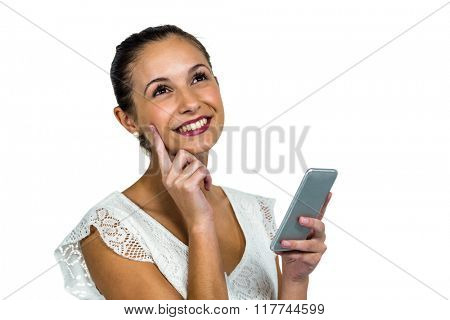 Smiling thoughtful woman holding smartphone on white screen