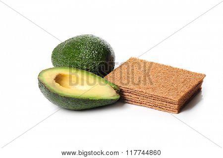 Sliced avocado on a white background