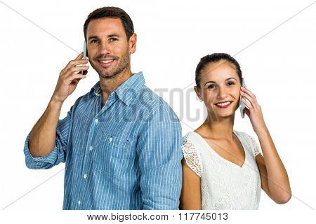 Portrait of couple on phone call looking at the camera on white screen