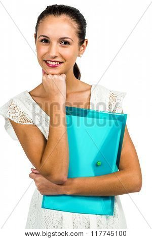 Smiling woman holding plastic holder with fist on chin on white screen