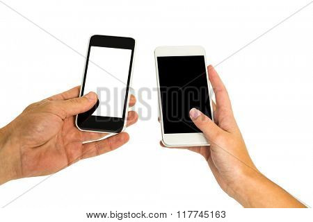 Hands holding smartphones on white screen