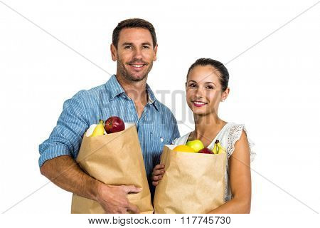 Couple holding grocery bags on white screen