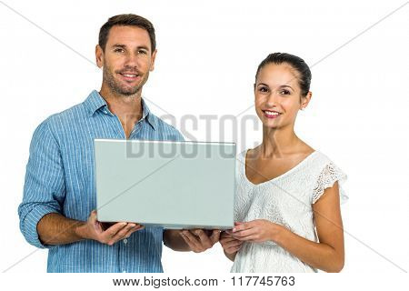 Young couple holding laptop and looking at camera on white screen