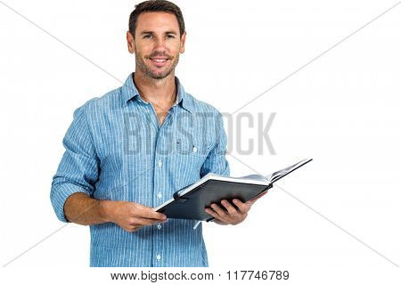 Smiling man holding book on white screen