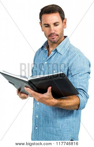 Handsome man reading book on white screen