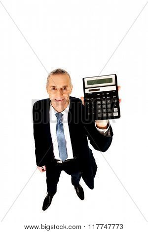 Happy businessman holding a calculator