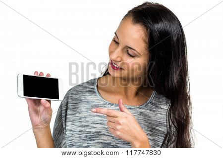 Woman showing smartphone screen at camera on white screen