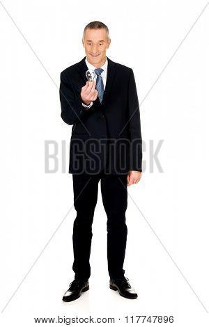 Full length shocked businessman with light bulb