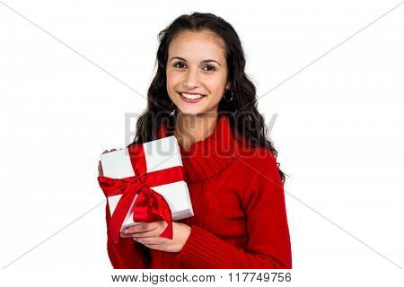 Smiling woman holding gift box on white screen