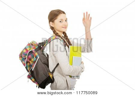 Schoolgirl waving her hand.
