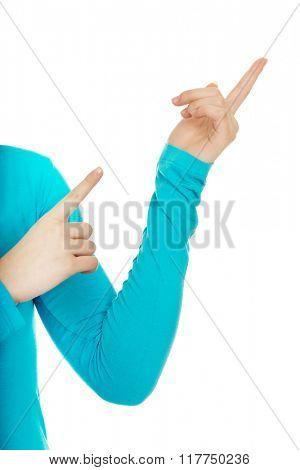 Woman's fingers pointing up.