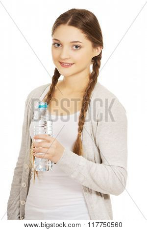 Beautiful woman with bottle of mineral water.