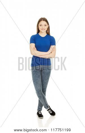 Teenage woman with crossed arms.