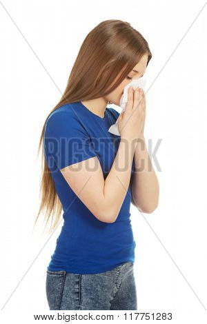 Young woman using a tissue.