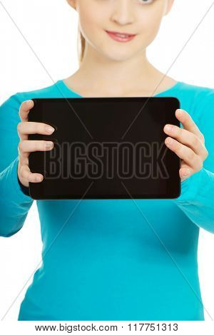 Teenager holding a tablet.