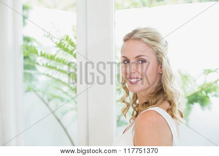 Beautiful woman smiling at camera in the bathroom