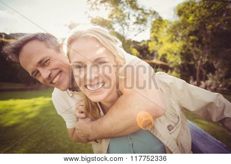 Cute couple with arms around each other outside