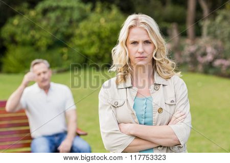 Upset woman sulking her boyfriend in the garden