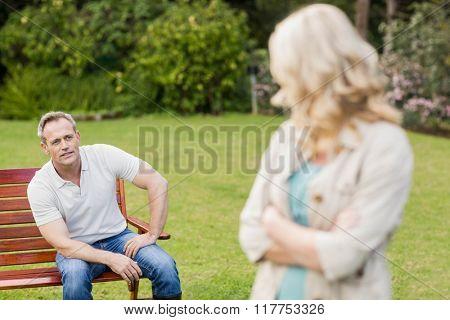 Upset couple having an argument in the garden