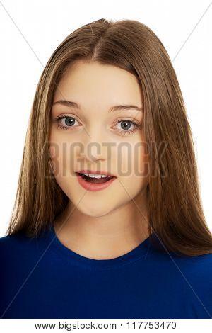 Shocked teenage woman.