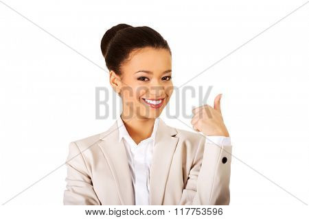 Businesswoman with thumbs up.