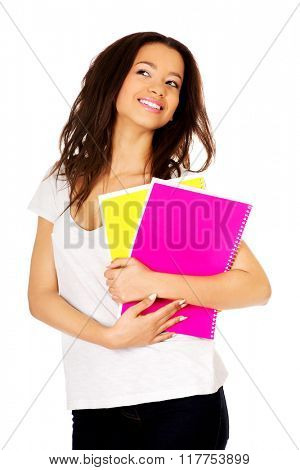 Young student woman with notes.