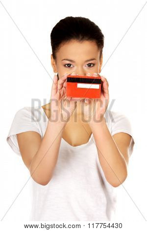 Happy woman holding a credit card.