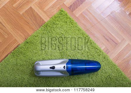 Handheld Vacuum Cleaner On The Carpet