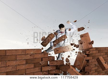 Businessman crashing bricks