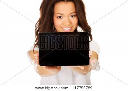 Woman showing tablet computer.