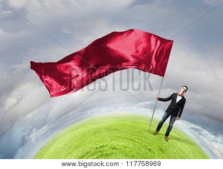 Man with red waving flag