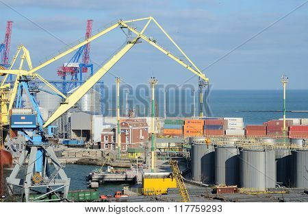 Odessa cargo port with grain dryers, transport containers and colourful cranes,Ukraine