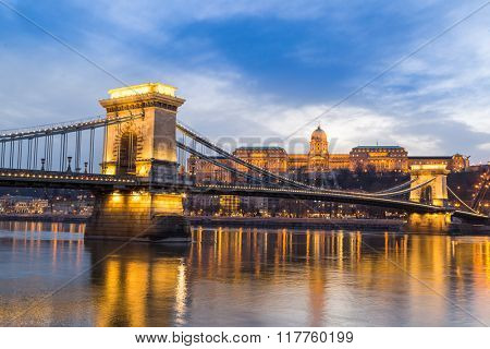 Dusk at bridge on Danube river with lights, Budapest city Hungary.