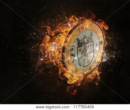 Euro coin burning in fire